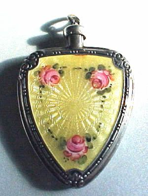 Antique French Sterling silver and enamel guilloche Perfume Bottle Pendant OLD mini Perfume Bottle.   It is decorated with French enamel guilloche with pink roses. There is scroll engraving on both sides of the edges. A rare piece.  $665.00