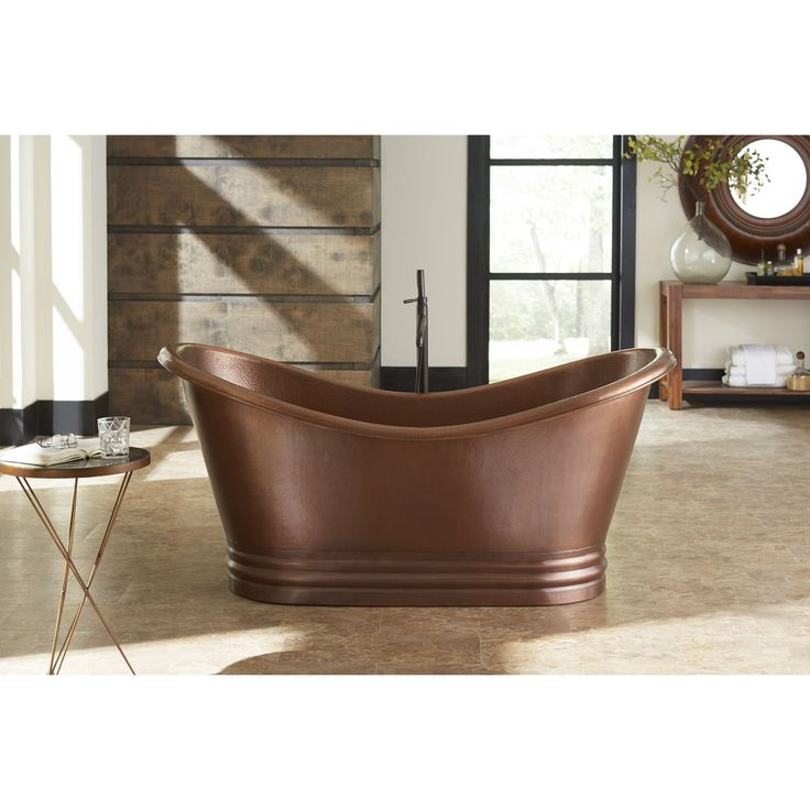 Enjoy a stately accent in your bathroom decor with this gorgeous tub, crafted from 100-percent pure copper. Don't settle for a boring white bath tub, choose a Sinkology copper bathtub and make a statement.