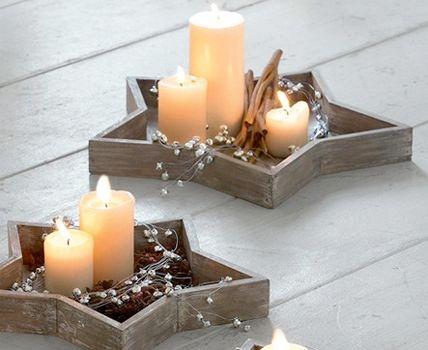 Holzsterne mit Kerzen