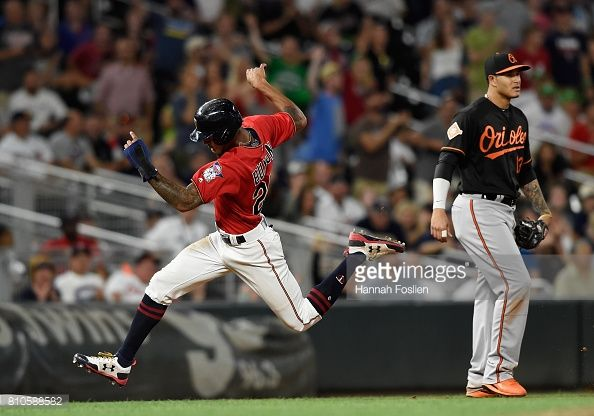 News Photo : Manny Machado of the Baltimore Orioles looks on...