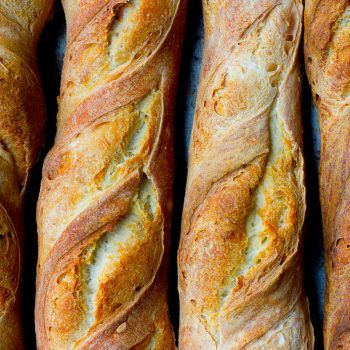 This classic French baguette recipe breaks down the step-by-step process to achieve artisan homemade baguettes! This recipe produces authentic French baguettes with a crusty outside and a fluffy, chewy inside.~ Baker Bettie