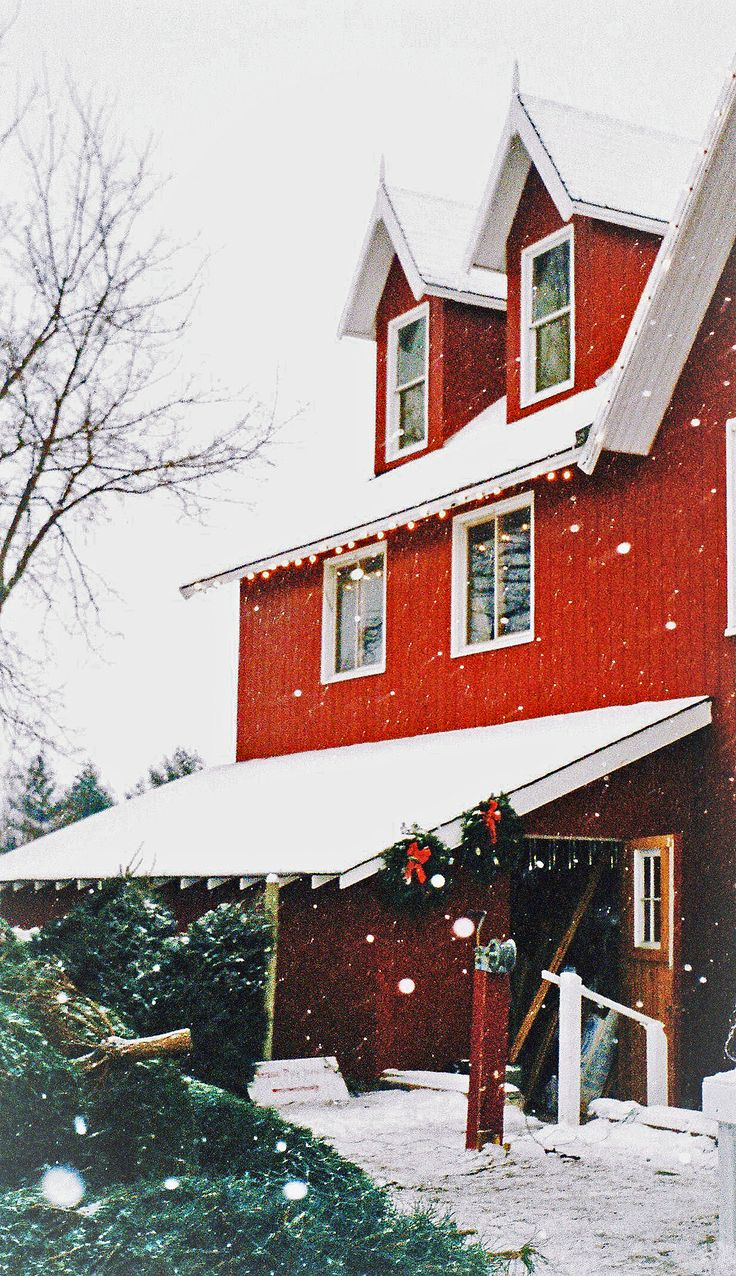 Christmas is white snow against a red building with a few greens thrown in for good measure.