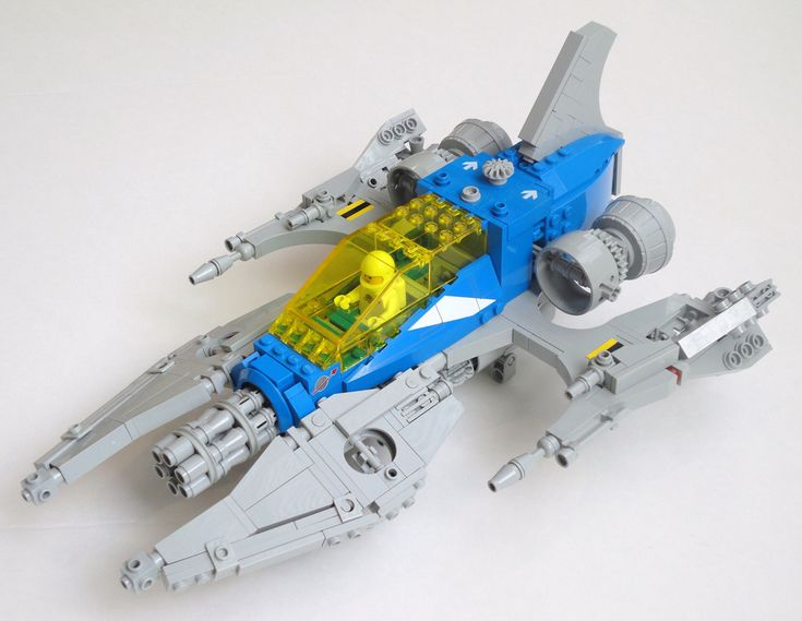 "https://flic.kr/p/8XtKG4 | Star Hammer (LL-925) | The LL-925 ""Star Hammer"" is my first Neo-Classic Space creation, inspired by my desire to modernize the original Lego Space Cruiser (LL487/LL924) set from 1979.  The model contains original, unmodified Lego parts (and 2 stickers) from 1979-2010.  I wanted to retain many of the signature features of the Lego LL924 set, including: A) the two seat capability with a large transparent yellow canopy, B) the ""split open"" cargo ba..."
