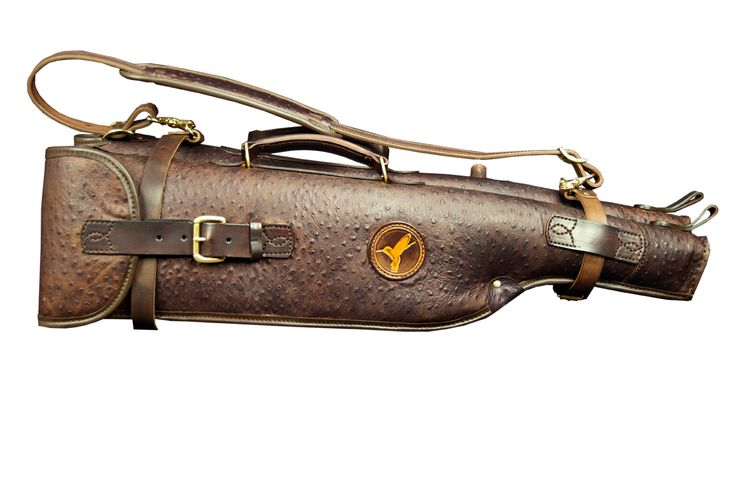 This Double Leather Takedown Shotgun Case Holds up to 30″ barrels.  Complete with leather straps with gold buckles and a sturdy leather removable carrying strap.  The interior features Sheepskin for superior padding and protection.  The total length of this case is 33″.  Available in Dark Brown. $2,750.00