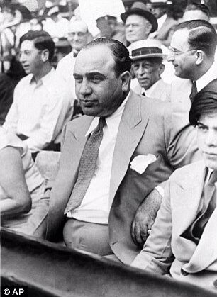 Al Capone attending a charity baseball match in Chicago. The scar on his cheek can been seen clearly | courtesy of AP via DailyMail
