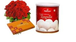 Exclusive combo of fresh 12 red roses hand bouquet with 1 kg. Rasgulla from Standard Sweets Shop/Haldirams along with small Cadbury celebrations pack - Send this exclusive gift to your loved ones through us.