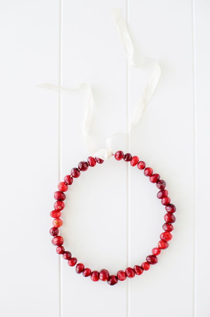 Make a holiday cranberry wreath for Christmas.