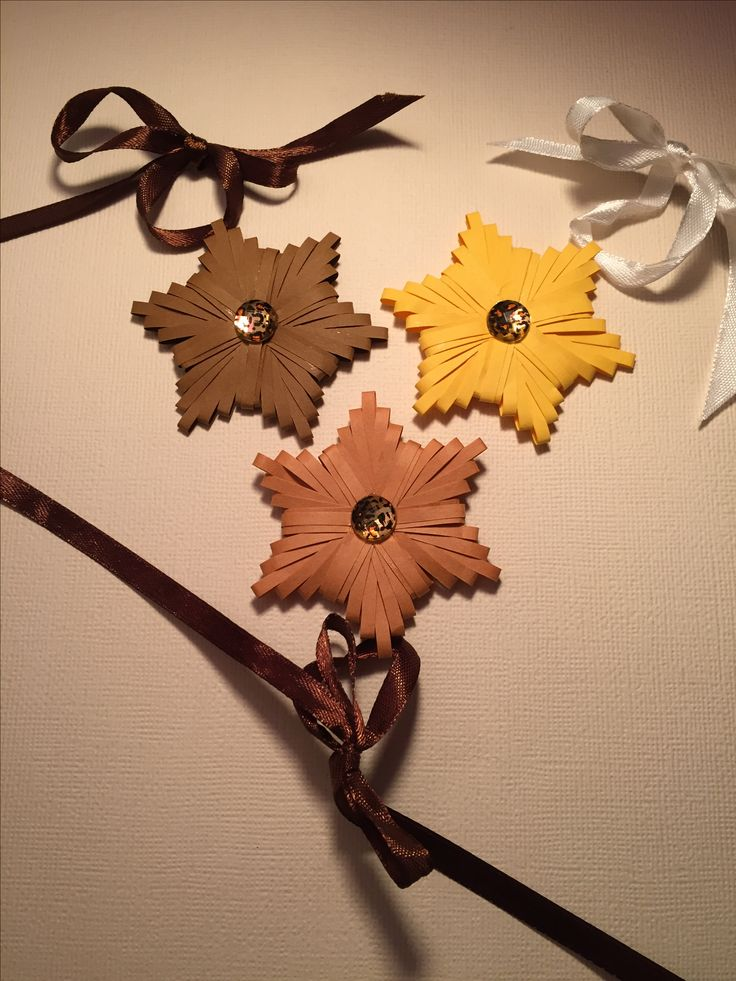 Handmade paper quilled star ornaments.