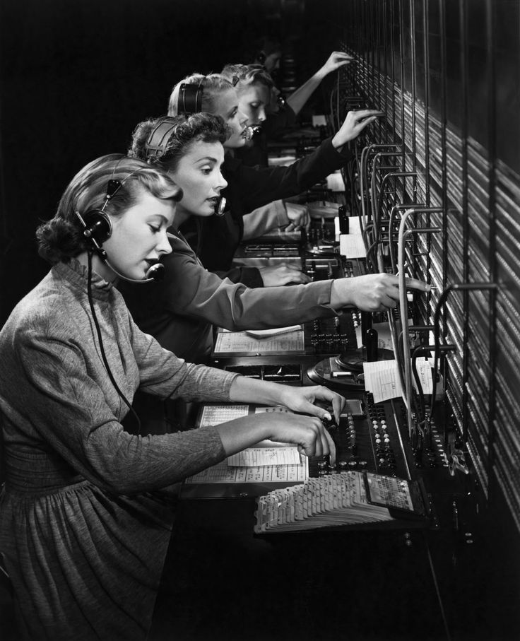 Wonderful shot of vintage switchboard operators. Memories of working with this type of switchboard.