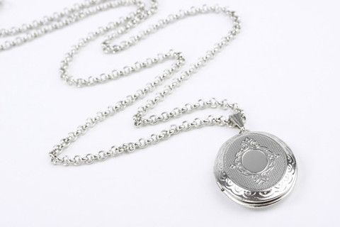 Sweet Memores Locket Silver: This romantic statement necklace makes a gorgeous vintage style gift for someone to share memories with. Oval opening locket suspended on fine belcher style chain. Real rhodium electroplated over brass. Chain length 23.5 inches / 60 cm. $99.90