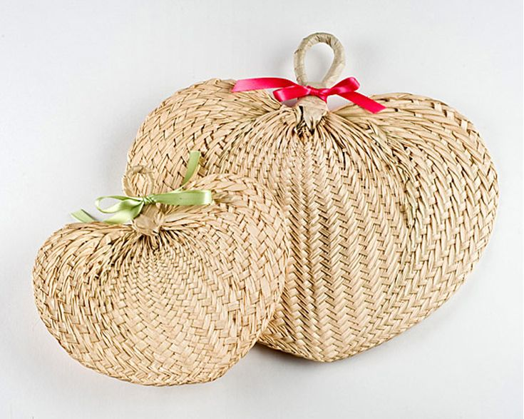 Woven bits of wicker and raffia go well with tropical chic weddings, especially if they use the raw brown shades as opposed to white painted wicker. You could use wicker chairs, raffia place mats and more. And since tropical weddings can get rather hot, your guests will thank you for these raffia fans. | Add Raffia and Wicker Accents | 5 Ways to Decorate a Tropical Chic Wedding | My Wedding Favors