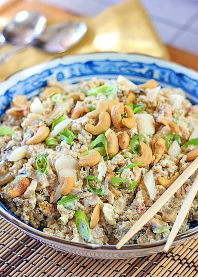Asian Rice Salad 2 5 oz boxes of Brown and Wild Rice blend ½ cup plain greek yogurt ½ cup mayonnaise ¼ cup dijon mustard 1 6 oz can water chestnuts - drained and coarse chopped ½ cup cashews - coarsely chopped (hold out a few whole ones for garnish if you would like) ½ cup sliced green onion ⅓ cup Yoshida's teriyaki sauce 1 teaspoon ground ginger Salt and pepper to taste (go low, the box rice already has lots of sodium)