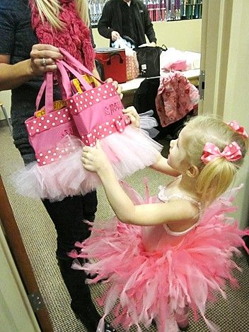 Goodie bags for a girl's party -- glue tulle & ribbon onto pink gift bags