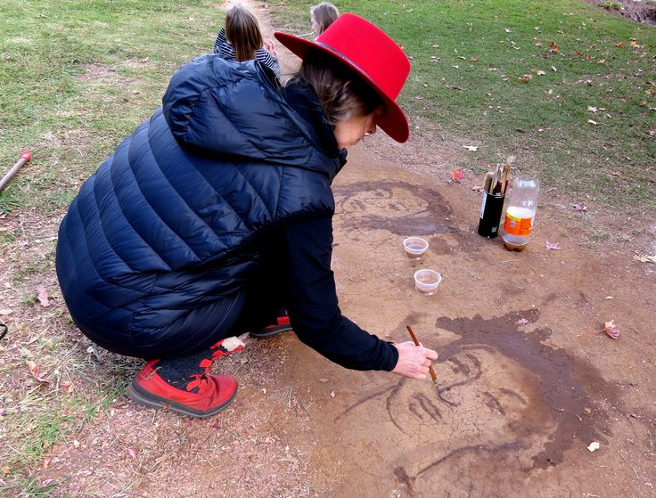 Anni Snyman painting on the pathway with water. Photographer - Gail Scott Wilson