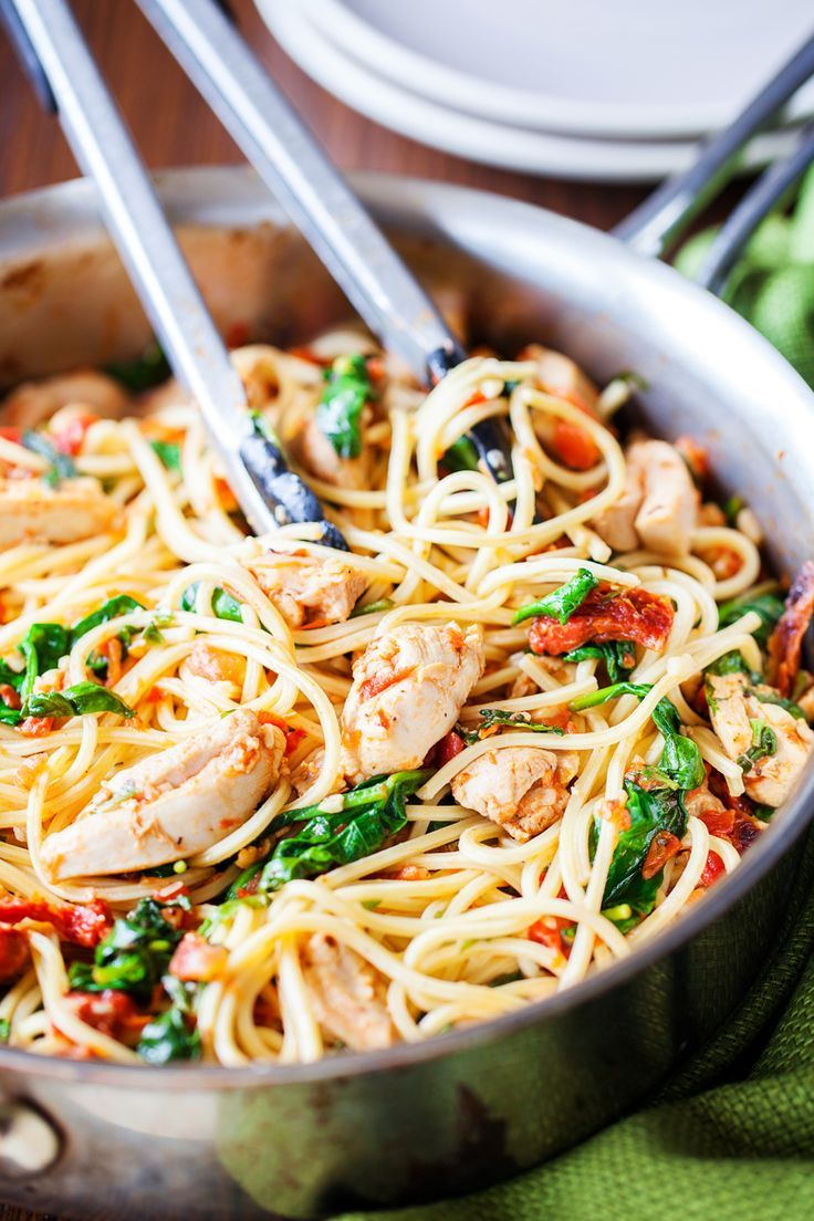 Tomato Spinach Chicken Spaghetti from iamhomesteader.com | One bite of this Tomato Spinach Chicken Spaghetti and you will never buy jarred tomato sauce ever again. Spaghetti is tossed in a fresh and flavorful sauce with pieces of juicy chicken. Fresh spinach adds a boost of nutrients, but feel free to use other vegetables to customize to your family's liking.