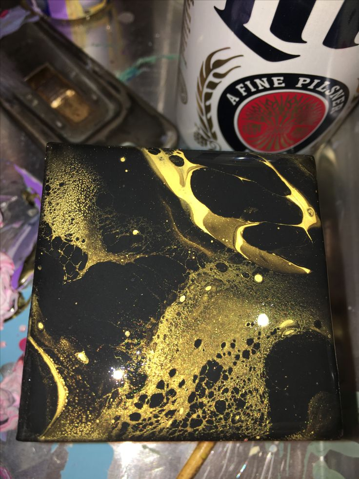I had some vitamin E oil and chamomile oil laying around and thought I would try a few drops of that instead of silicone just to play around I also mixed in Liquitex Pouring Medium. Turned out  beautiful I did a few more small canvases with this same technique but with colors added check them out they are so cool.