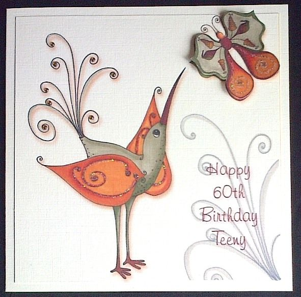 Order code: 091412 Another fantasy bird to show you. This one is printed onto ivory card stock. The colours are just beautiful! A little glitter has been added to the swirls and sparkly gems to finish the tail feathers. Makes a really different 60th birthday card.