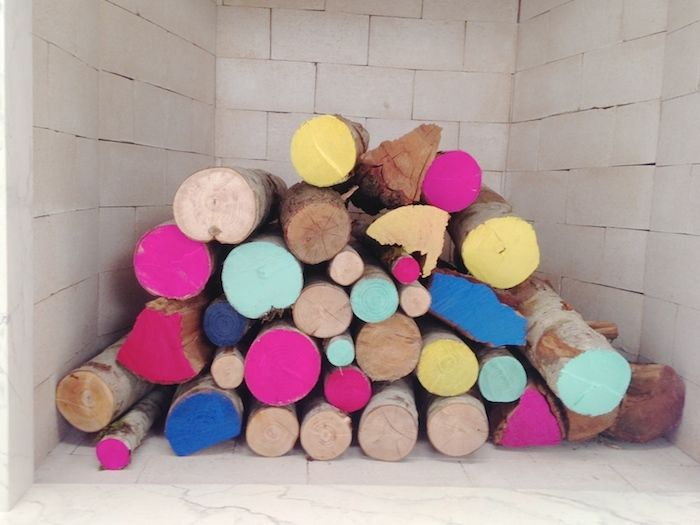 Paint end of logs for non-funtioning fireplace