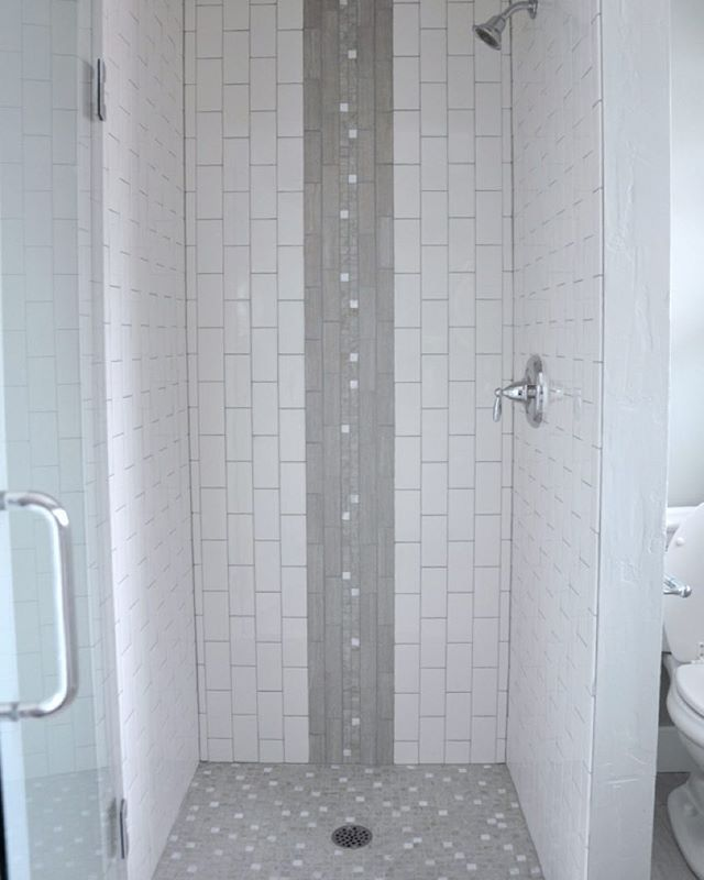 Vertical shower tile. My favorite part was how the white tiles in the accent…