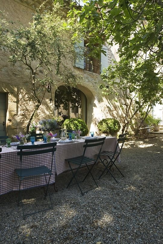 Roses and Rust: Gorgeous Garden in Provence featuring Bistro chairs in Cedar Green http://www.jardin.co.nz/collections/bistro/bistro-folding-chair/