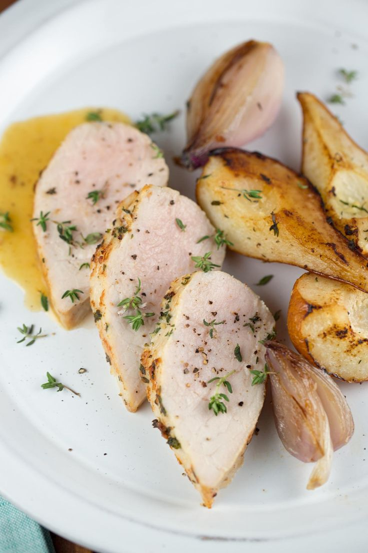 Delicious seasoned pork tenderloin served with pears and shallots - a simple, elegant recipe and healthy feast! Roasted with fresh herbs and served with a delicious pear pan sauce | jessicagavin.com