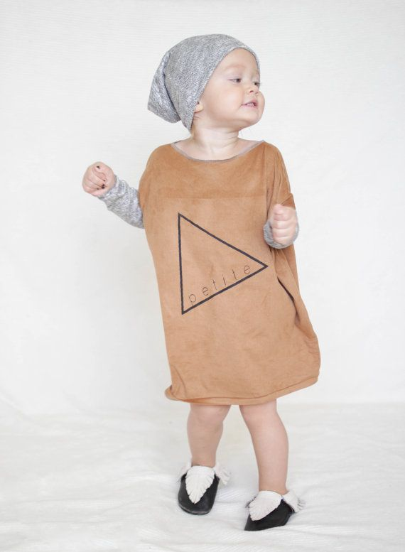 This awesome dress goes with everything. It is made out of soft suede fabric with gold knit sleeves. Its simple but looks so cute! Perfect for any