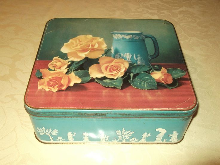 Arnotts biscuit tin - Wedgwood blue tin with yellow roses & jug on lid