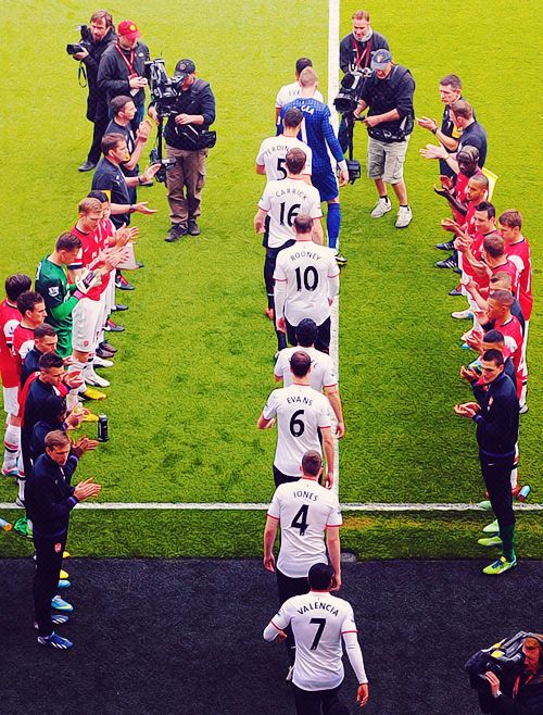 Manchester United take to the field against Arsenal.