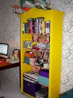 My workspace, a yellow old bookcase with some creative stuff and some decorating books.