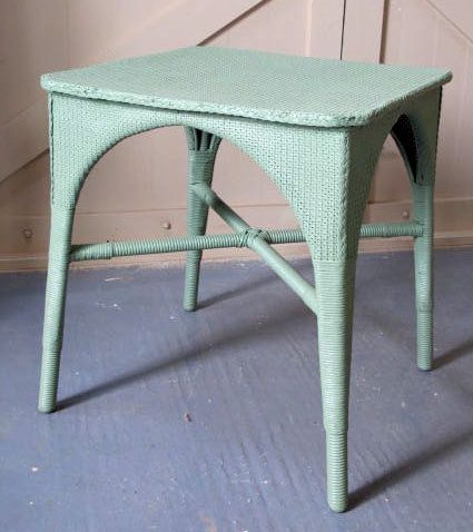 A vintage Lloyd Loom table,