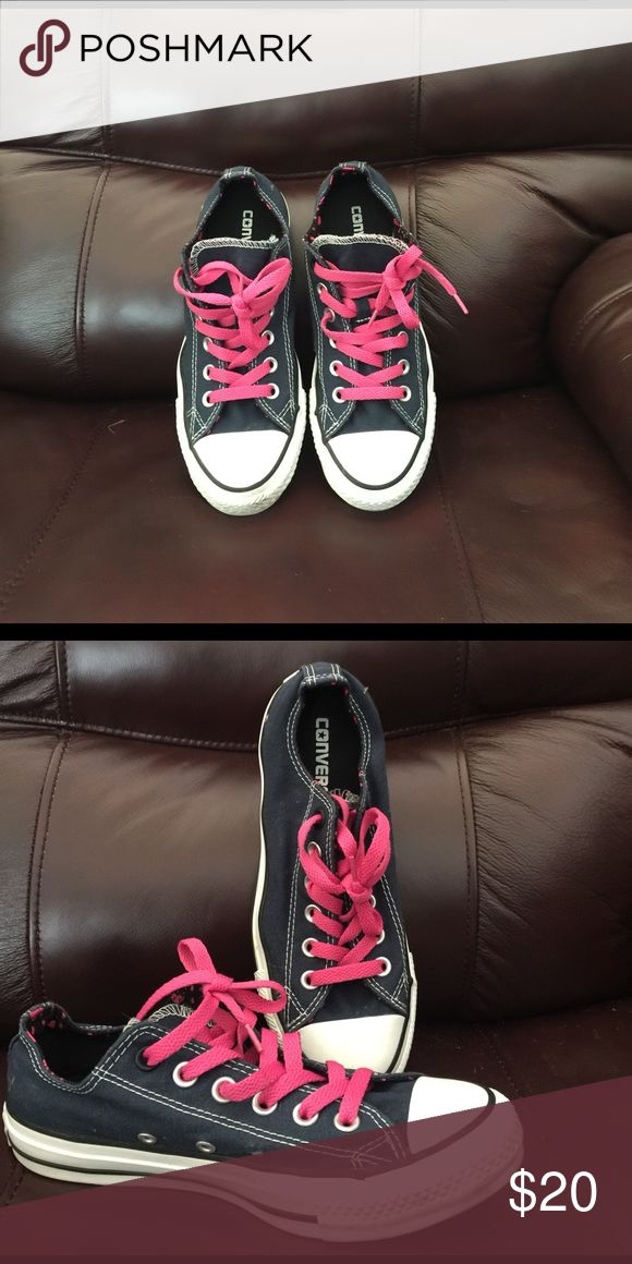 Shoes Converse navy blue with pink shoe laces size is 7 for women but the bottom said 5 because can wear unisex looks brand new use them couple times. Converse Shoes Sneakers