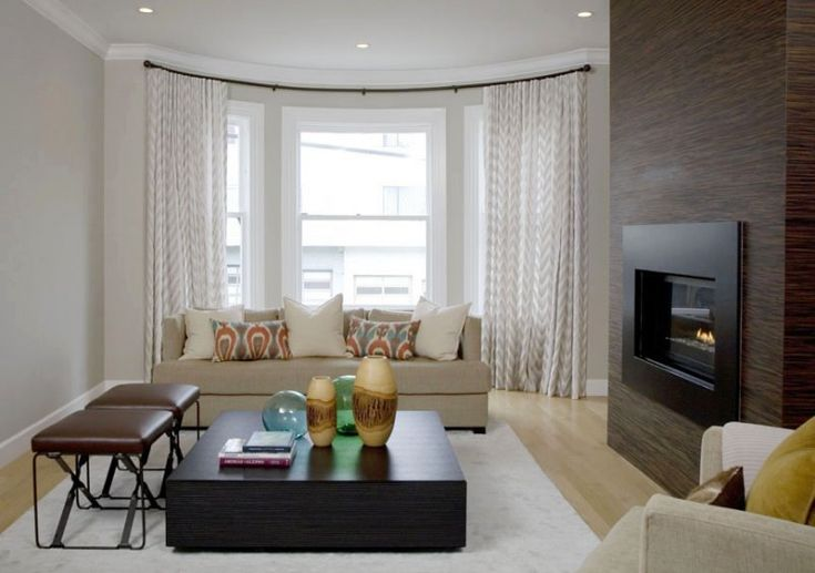 Custom curtains for a dramatic bow window in this modern SF living room. An amazing embroidered linen blends this classic architectural feature with the modern interior design beautifully.