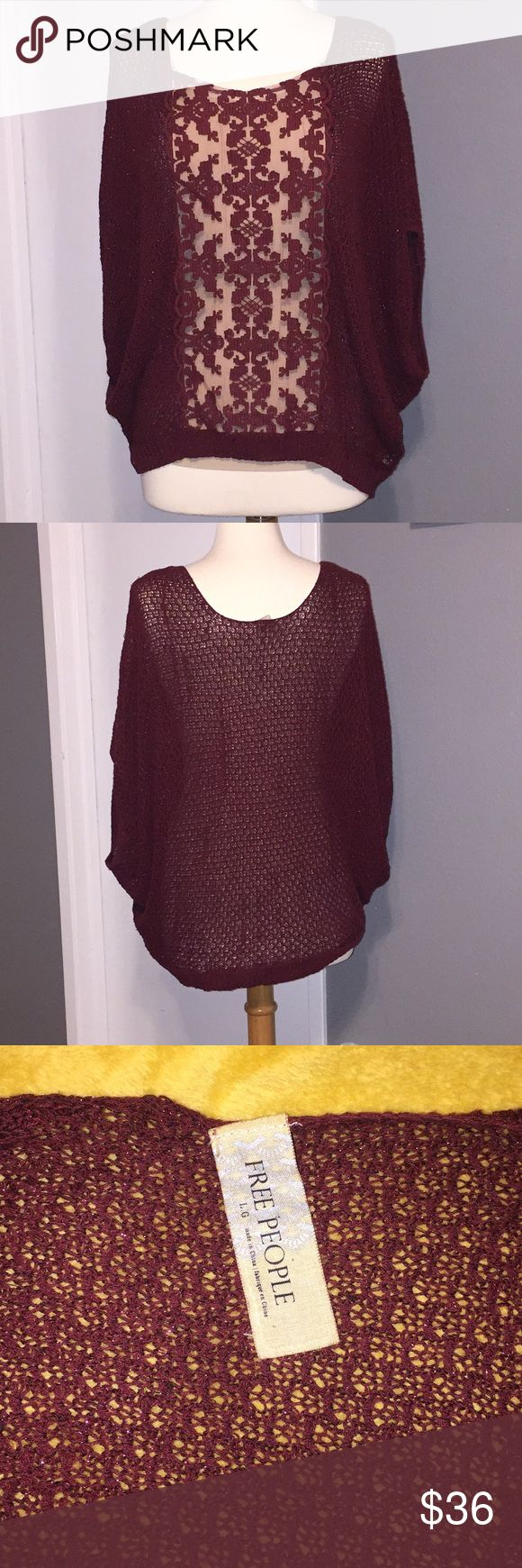 Oversized Free People maroon sweater with lace This oversized sweater has short sleeves and fun, flirty lace down the front. This piece is see through so a cami must be worn underneath it. Great with jeans or dress pants for a work outfit! Free People Sweaters Crew & Scoop Necks