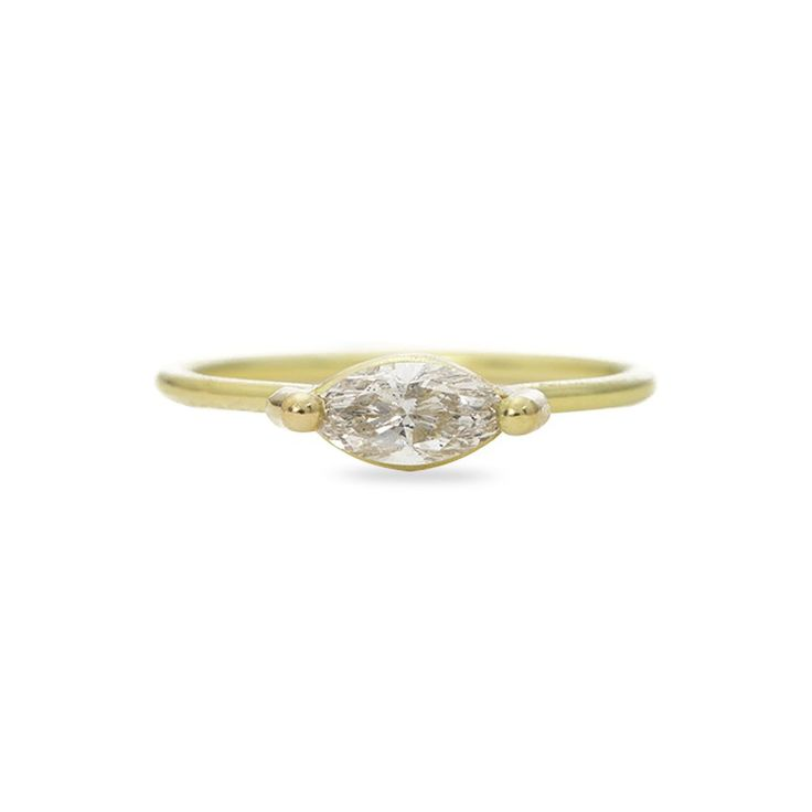 Feminine and delicate, the Marquis Ring by Tura Sugden is perfect for a woman who seeks an airy adornment. The stunning marquis cut diamond is held by Tura's signature setting along a thin band. #engagementring #turasugden