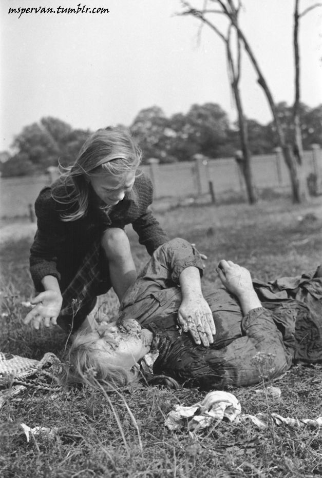 A daughter and her injured mother. WWII. Via mspervan.tumblr.com