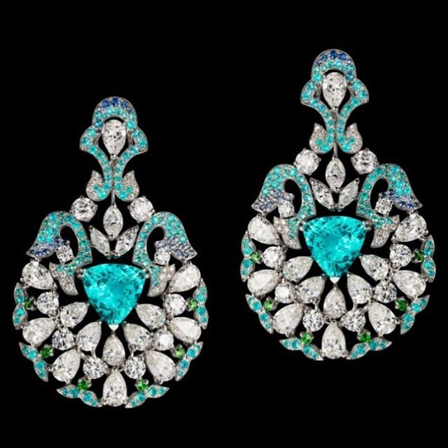 "Orlov Jewelry a pair of ""piscine blue"" Paraiba and diamond earrings - their spirited turquoise/ blue colour is not found in any other gemstone. The exclusiveness of this legendary find makes these rare gemstones real treasures."