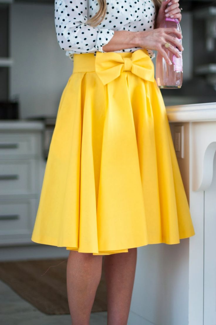Polka dots and yellow bow. Loooove! Want to make a skirt like this just longer for my taste:)