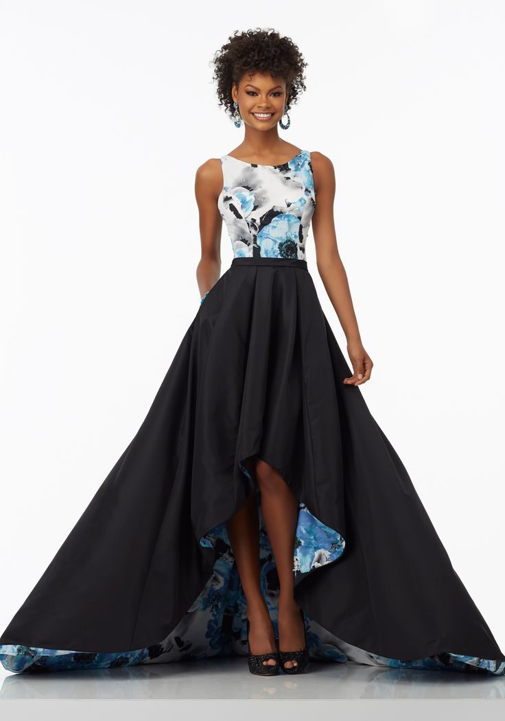 Floral Printed Taffeta A-Line Prom Dress with Delicately Beaded Bodice and Hi-Low Hemline. Double Strap Back Detail. Colors Available: Black/Blue Floral