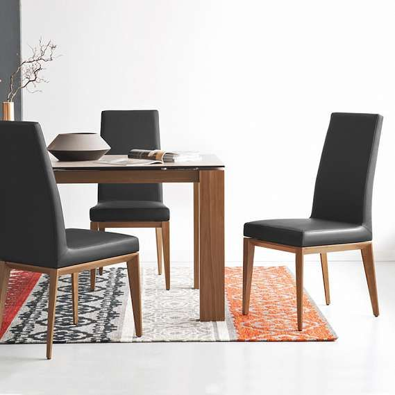 The Bess Dining Chair By Calligaris Features A Comfortable High Back Rest  And Upholstered Seat.