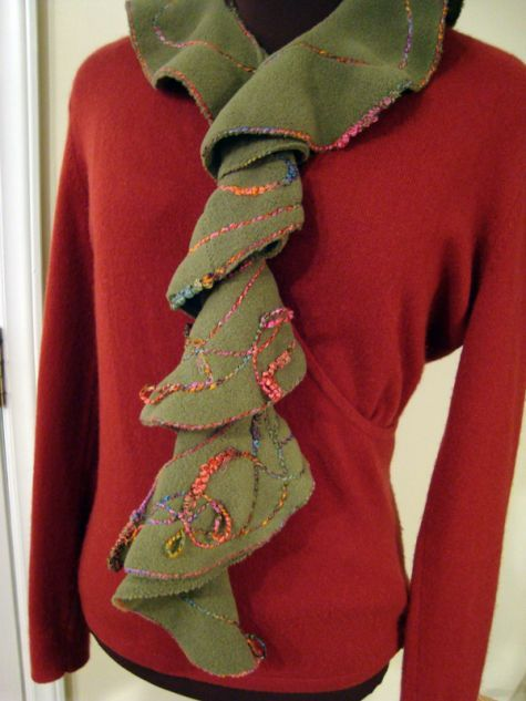 Start with a circle. Then add some yarn to make an accessory that will warm your neck and dress up your outfit.
