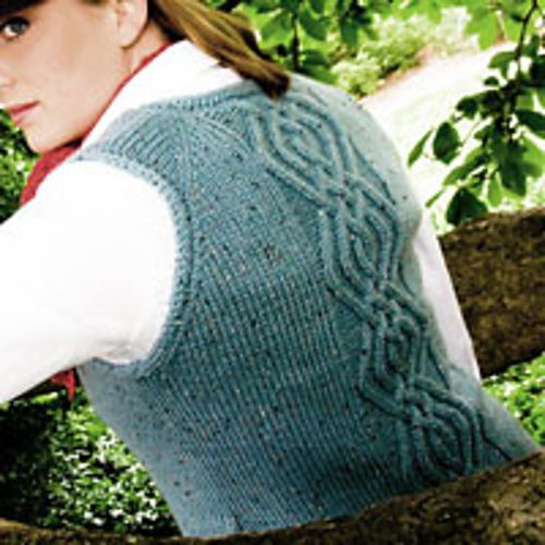 Bramblewood vest from Classic Cable Knits, designer Christina Wall. I loved making a red one of this vest. The pattern is free at www.knotions.com.