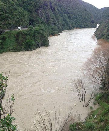The Manawatū River in flood today seen from the Fitzherbert Bridge.