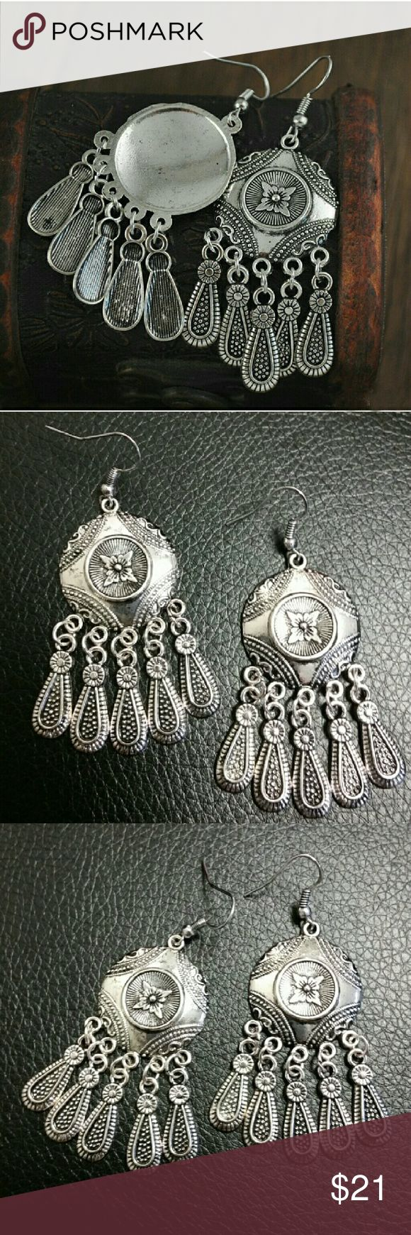 *weekend sale* Embossed silver dangling earrings Eye-catching dangling earrings with teardrop charms and flower detail in the center. Very beautiful for a boho look Jewelry Earrings