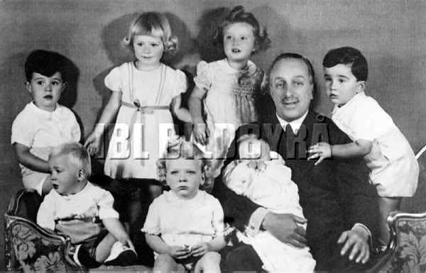 Infanta Beatriz's 2 eldest children, Dona Sandra (standing, left) and Don Marco (with curly hair) with their grandfather King Alfonso XIII and cousins, including a toddler King Juan Carlos (sitting, left).  April, 1939.