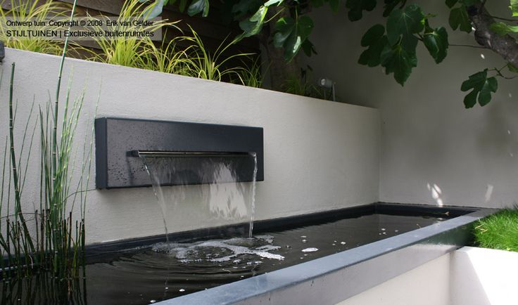A simple water feature in a contemporary garden by rodenburgtuinen.nl