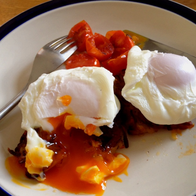 Home made hash brown, poached eggs and tomatoes. Breakfast of winners.