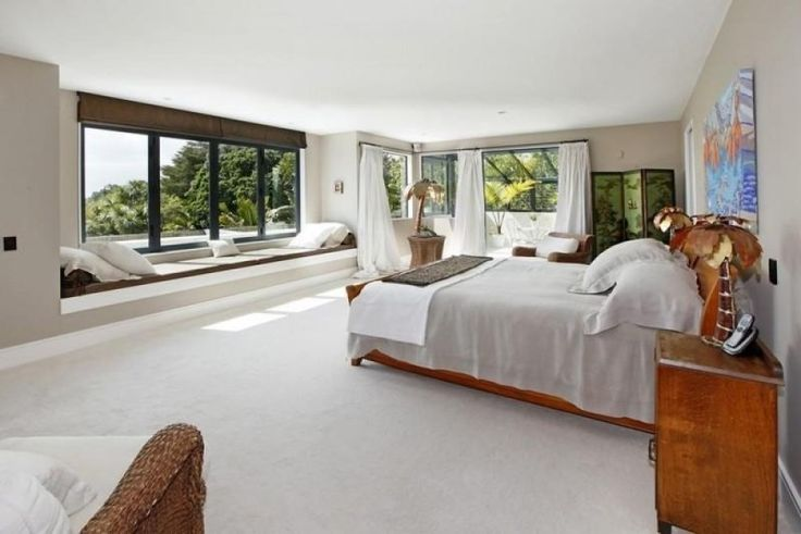 Expansive master bedroom with a window seat