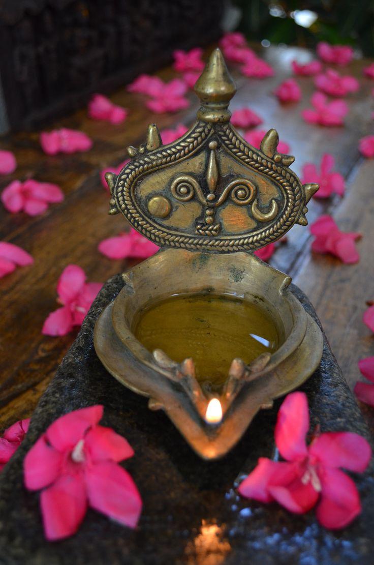 Antique Vishnu brass lamp. Depicting the Sun, mark of Vishnu, the Moon and flames of fire.