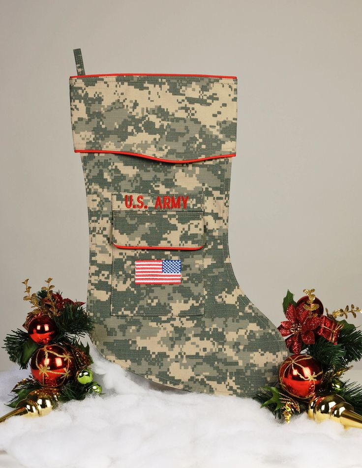 """A perfect gift for the Soldier on your list. The Army Christmas stocking is beautifully tailored in the Army ACU digital camouflage fabric. Trimmed in scarlet piping with the """"reverse American flag"""" embroidered on the stocking pocket. Did someone mention a Christmas Care package?  www.camosock.com"""