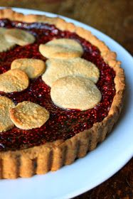 Nothing says Christmas like a vibrantly red Linzer tart, that has a flakey crust filled with homemade raspberry jam .              ...